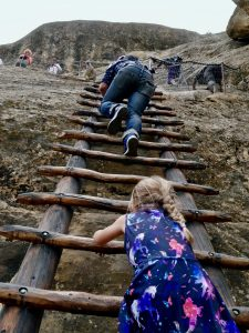 Climbing steep ladders on cliffs